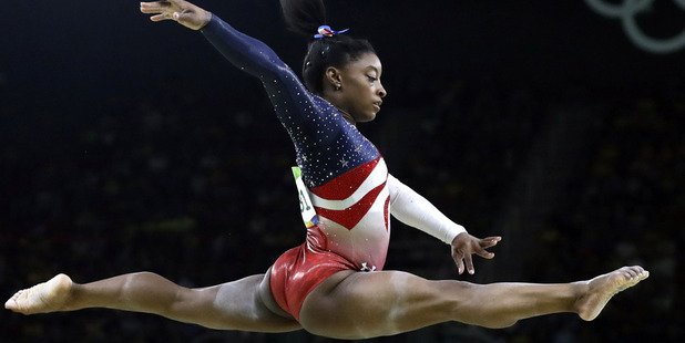 United States' Simone Biles performs on the balance beam. Photo / AP