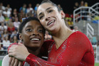 United States' Simone Biles, left, and Aly Raisman embrace after winning gold and silver respectively for the artistic gymnastics women's individual all-around final. Photo / AP