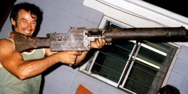 Ivan Milat in 1983, holding World War One vintage machinegun. Photo / News Corp Australia