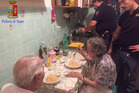 The police officers, who are used to looking after a notorious mafia area, were moved by the lonely couple's plight and wanted to help cheer them up. Photo / Facebook / Questura di Roma