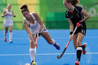 New Zealand's Pipa Hayward, left, challenges with Germany's Franzisca Hauze. Photo / AP