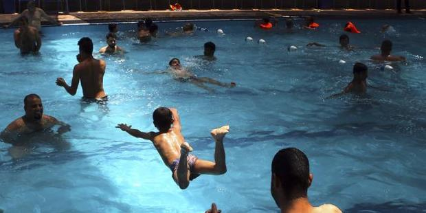 The situation is especially dire for people who don't have access to air-conditioning or swimming pools. Photo / AP