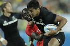 Kenya's Humphrey Kayange, back, tackles New Zealand's Rieko Ioane. Photo / AP