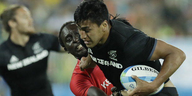 Kenya's Humphrey Kayange, back, tackles New Zealand's Rieko Ioane. Photo / AP