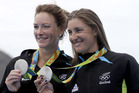Genevieve Behrent and Rebecca Scown, of New Zealand, celebrate their silver in the women's rowing pair final. Photo / AP