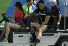 New Zealand's Sonny Bill Williams is driven out of the stadium by medics during the side's shock loss to Japan. Photo / AP