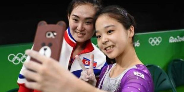 Their countries are at war but these two gymnasts have captured the Olympic spirit with a selfie. Photo / Ian Bremmer