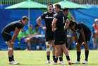 The New Zealand sevens team look dejected following their shock defeat to Japan. Photo /Getty