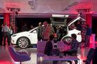 Guests look at a Tesla Model X at the Tesla Motors showroom in San Francisco. Photo / David Paul Morris