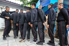 Thai soldiers wait in line to check voter lists during Thailand's constitutional referendum in Bangkok. Photo / Bloomberg