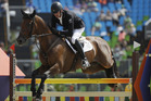 Mark Todd, of New Zealand, riding Leonidas II, competes in the equestrian eventing team show jumping. Photo / AP