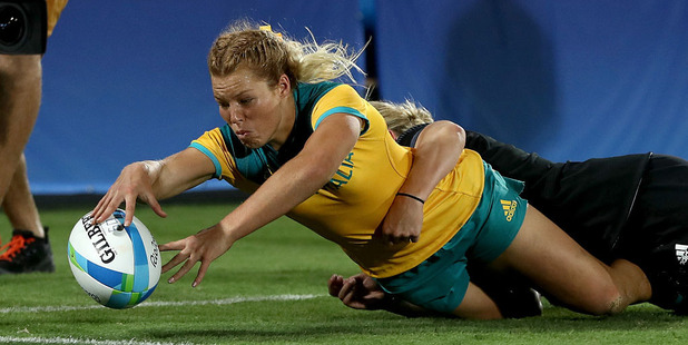Loading Emma Tonegato of Australia scores a try in the gold medal match but replays showed she may have lost control of the ball. Photo /Getty