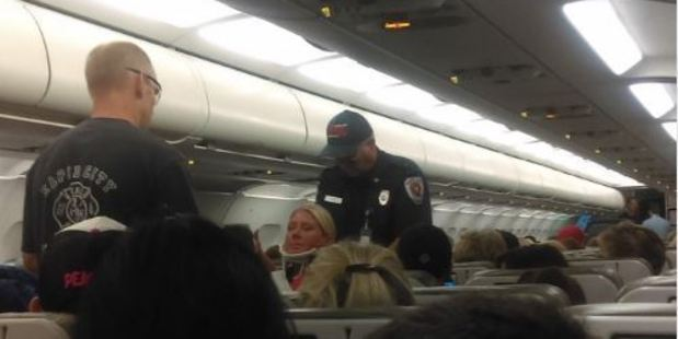A flight attendant is fitted with a neck brace after the horror Jetblue flight. Photo RhondaRenee Twitter