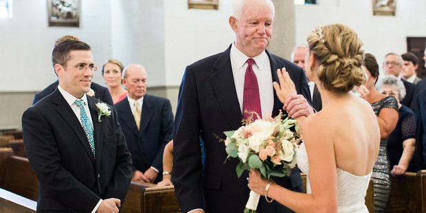 Stepien touches Thomas' chest where her father's heart is beating right before she turns toward her groom. Photo / Lauren Renee Designs