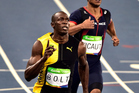 Usain Bolt celebrates after winning his third Olympic gold medal in the 100m sprint at Rio de Janeiro yesterday. Photo / Photosport