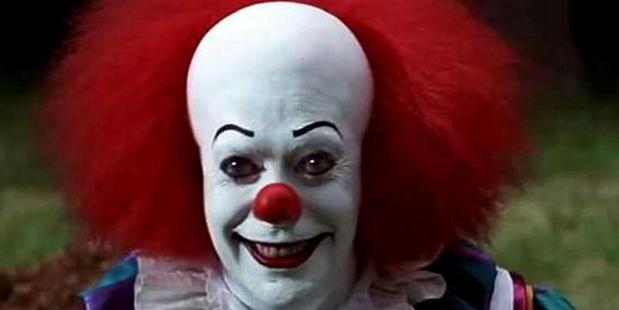 Tim Curry as the original Pennywise, fuel for a generation's nightmares.
