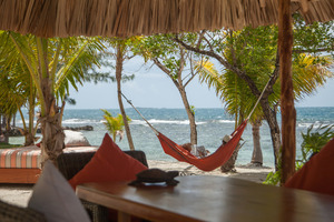 Hang out in a hammock and enjoy the serenity at Coral Caye, off the coast of Belize. Photo / Benedict Kim, Supplied
