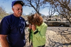 Miguel and Mabel Ramos, both 73, are distraught at the devastation caused by the Blue Cut Fire. Photo / Getty Images