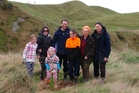 Dannevirke farmers Marina and John Poulton (left) with their children, Zeari, Isobel and Milly, and John's parents Bev and Rod Poulton.