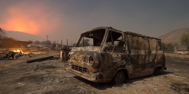 Fires in California this week surged across more than 120 square kilometres and forced 82,000 people to flee their homes. Picture / AP