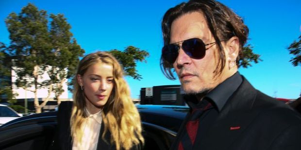This photo, taken on April 18, 2016, shows US actor Johnny Depp and his wife Amber Heard arriving at a court in the Gold Coast in Australia. Photo / AFP