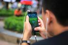 A man plays Pokemon Go at a popular PokeStop in Hanoi, Vietnam. Photo / AP
