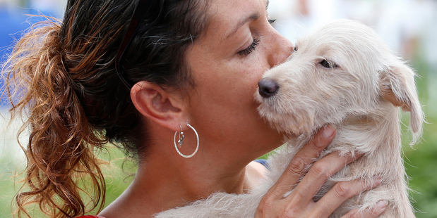Lisa Tucker, of Miami, with her terrier mix dog. Photo / AP