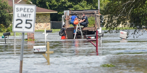 Residents on Carmel Drive are rescued from rising flood waters in Lafayette, Louisiana. Photo / AP