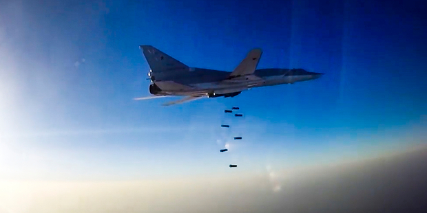 In this frame grab provided by the Russian Defence Ministry, Russian long range bomber the Tu-22M3 flies during an air strike over the Aleppo region of Syria today. Photo / AP