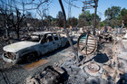Charred remains are seen in the town of Lower Lake, California. Photo / AP