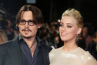 Johnny Depp cut off his fingertip during a fight with Amber Heard in an accident that delayed filming on the new Pirates of the Caribbean film for two weeks, a new report says. Photo/AP
