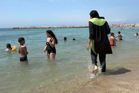 Nissrine Samali, 20, gets into the sea wearing a burkini in Marseille, southern France. Photo / AP
