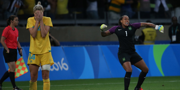 Australia's Alanna Kennedy , left, reacts after missing a shot in a penalty shootout as Brazil goalkeeper Barbara celebrates. Photo / AP