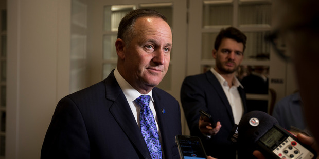 Prime Minister John Key addresses media , wearing a striking purple tie. Photo/ Dean Purcell
