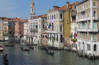 Gondoliers on a canal in Venice.