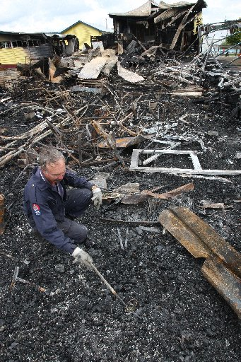 Fire investigator Lindsay Murray looks for clues at Moerewa's Te Kura Kaupapa Maori O Taumarere to determine what started the devastating blaze,  for which a 16-year-old girl was charged.