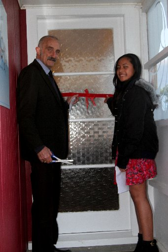 Mayor John Carter and 12-year-old Siobhan Hassan, who was first to cross the threshhold, about to cut the ribbon to open Awhi Mai Awhi Atu House.