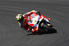 Italy's Andrea Iannone of the Ducati Team takes a curve at the Austrian MotoGP. Photo / AP