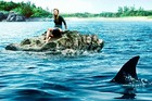 Blake Lively being terrorised by a Great White in the new Shark film, The Shallows.