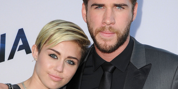 Miley Cyrus and Liam Hemsworth are reportedly looking for a new location for their honeymoon. Photo/Getty