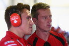 Holden Racing Team team principal Ryan Walkinshaw speaks with driver James Courtney. Photo / Getty Images