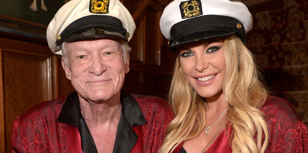 A TV series about Playboy boss Hugh Hefner, seen here with his third wife Crystal Hefner, is believed to be underway in Auckland. Photo/Getty