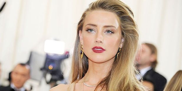 Amber Heard says as reported in the media, the amount received in the divorce was $7 million and $7 million is being donated. Photo / Getty Images