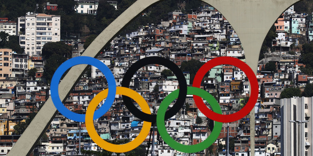 The Olympic Rings are seen with favelas in the background. Photo / Getty