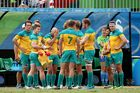 Australia players look dejected in defeat after the Men's Rugby Sevens placing 5-8 match against Argentina. Photo / Getty Images