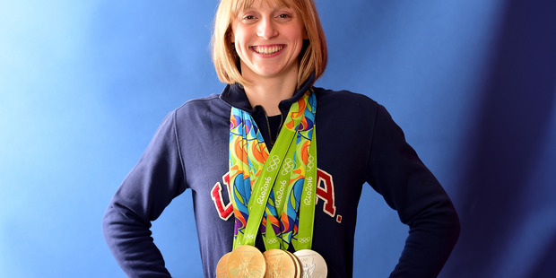 US swimming star Katie Ledecky displaying her medal haul before Michael Phelps passed on his valuable styling advice. Photo / Getty Images