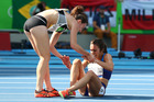 Abbey D'Agostino of the United States, right, is assisted by Kiwi Nikki Hamblin after the collision in the 5000m. Photo / Getty Images