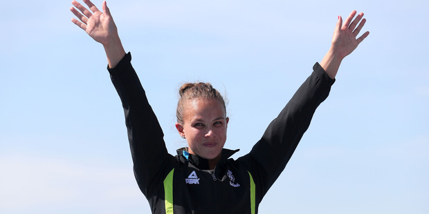 Loading Gold medalist Lisa Carrington celebrates on the podium at Rio after her women's K1 200m win. Photo / Getty Images