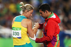Kim Mickle of Australia is assisted by medical staff after being injured during the javelin. Photo / Getty