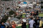 Tourists take photographs during a tour of the Rochina 'favela' community. Photo / Getty Images